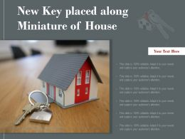 New Key Placed Along Miniature Of House