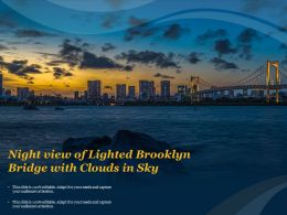Night View Of Lighted Brooklyn Bridge With Clouds In Sky