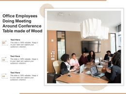 Office Employees Doing Meeting Around Conference Table Made Of Wood