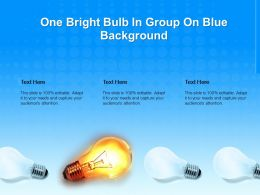 One Bright Bulb In Group On Blue Background