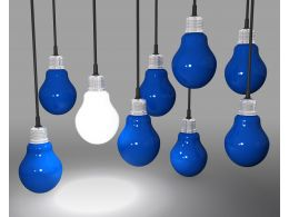 One Glowing Bulb As Innovation With Blue Bulbs Stock Photo