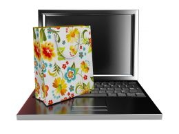 Online Shopping Graphic With Bag And Laptop Stock Photo
