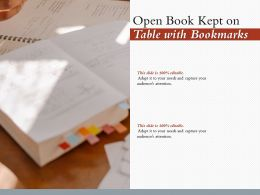 Open Book Kept On Table With Bookmarks