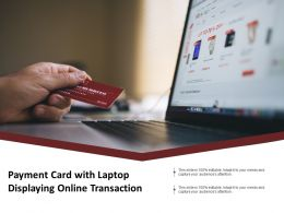 Payment Card With Laptop Displaying Online Transaction