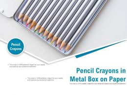 Pencil Crayons In Metal Box On Paper