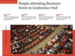 People Attending Business Event In Conference Hall