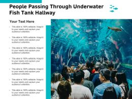 People Passing Through Underwater Fish Tank Hallway