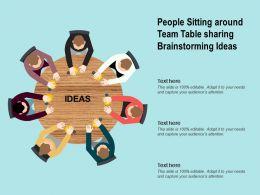 People Sitting Around Team Table Sharing Brainstorming Ideas