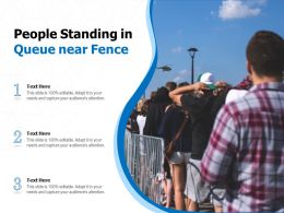 People Standing In Queue Near Fence