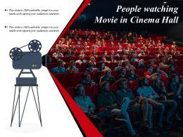 People Watching Movie In Cinema Hall
