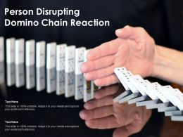 Person Disrupting Domino Chain Reaction