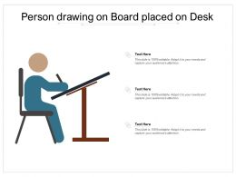 Person Drawing On Board Placed On Desk