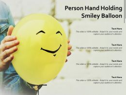 Person Hand Holding Smiley Balloon