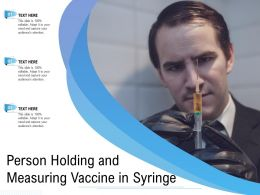 Person Holding And Measuring Vaccine In Syringe