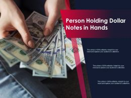 Person Holding Dollar Notes In Hands