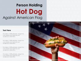 Person Holding Hot Dog Against American Flag