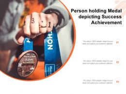 Person Holding Medal Depicting Success Achievement