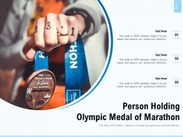 Person Holding Olympic Medal Of Marathon