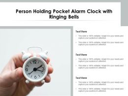 Person Holding Pocket Alarm Clock With Ringing Bells