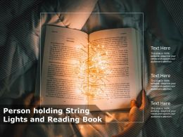 Person Holding String Lights And Reading Book