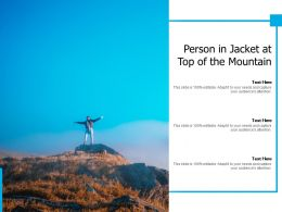 Person In Jacket At Top Of The Mountain