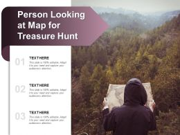 Person Looking At Map For Treasure Hunt