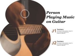 Person Playing Music On Guitar