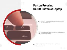 Person Pressing On Off Button Of Laptop