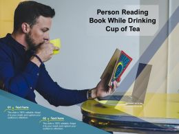Person Reading Book While Drinking Cup Of Tea