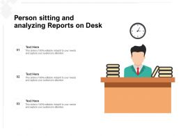 Person Sitting And Analyzing Reports On Desk