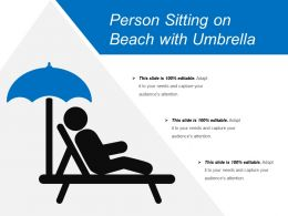Person Sitting On Beach With Umbrella