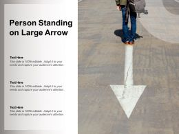 Person Standing On Large Arrow