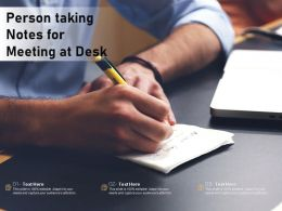 Person Taking Notes For Meeting At Desk