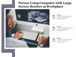 Person Using Computer With Large Screen Monitor At Workplace