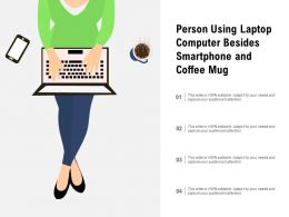 Person Using Laptop Computer Besides Smartphone And Coffee Mug