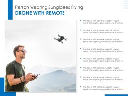 Person Wearing Sunglasses Flying Drone With Remote