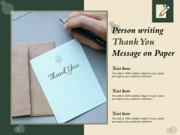Person Writing Thank You Message On Paper