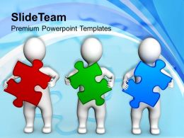 Persons Holding Puzzle Pieces Team Business Powerpoint Templates Ppt Themes And Graphics