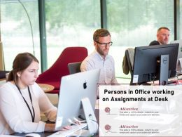 Persons In Office Working On Assignments At Desk