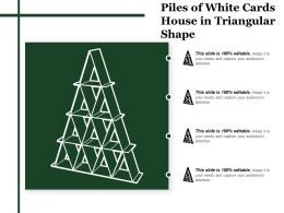 Piles Of White Cards House In Triangular Shape