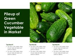 Pileup Of Green Cucumber Vegetable In Market