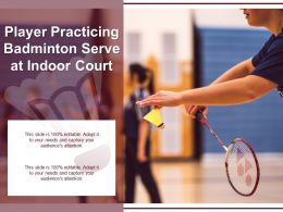 Player Practicing Badminton Serve At Indoor Court