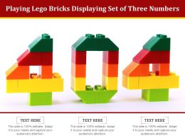 Playing Lego Bricks Displaying Set Of Three Numbers