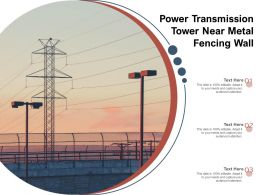 Power Transmission Tower Near Metal Fencing Wall