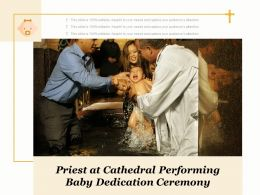 Priest At Cathedral Performing Baby Dedication Ceremony