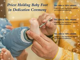 Priest Holding Baby Foot In Dedication Ceremony