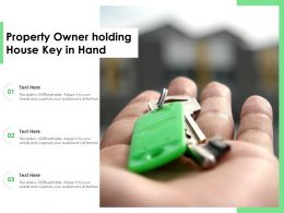Property Owner Holding House Key In Hand