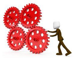 Pushing A Cogwheel To Make It Work Stock Photo