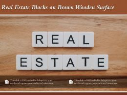 Real Estate Blocks On Brown Wooden Surface