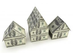 Real Estate Theme With Three Dollar Houses Stock Photo